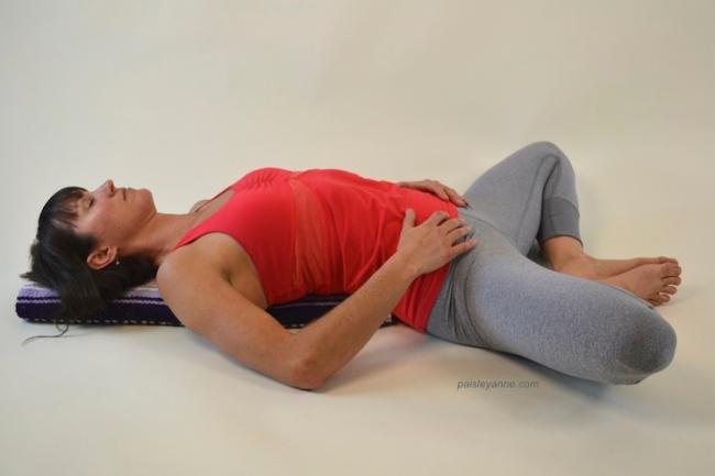Supda Baddha Konasana :: Reclining Cobbler's Pose on a blanket.