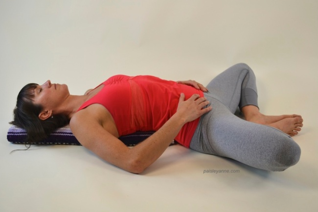 Supda Baddha Konasana :: Reclining Cobbler's Pose on a blanket.